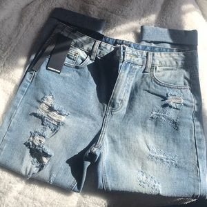 "NWT! Nasty Gal ""Rough Stuff"" Distressed Jeans."